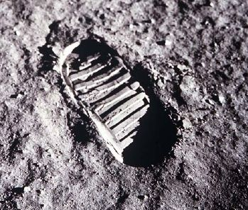 Black and white photo of a footprint on the lunar surface