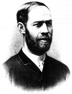 Black and white portrait of a man with a short beard looking to the right