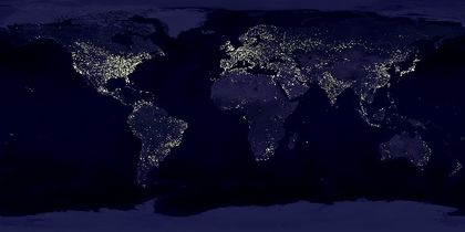 Satellite image of the Earth at night with numerous luminous dots, particularly in the northern hemisphere