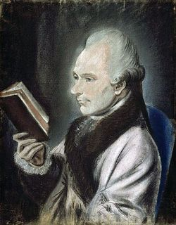 Pastel colour portrait of a man seated in profile, wearing a jacket with a brown fur collar and reading a book