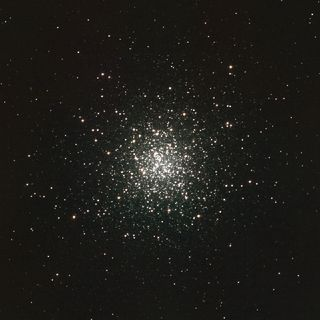 Concentration of very luminous white dots at the centre of the image against a very black background