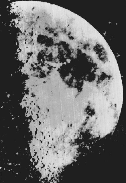 Black and white daguerreotype of the right side of the moon with spheres and black spots on its surface