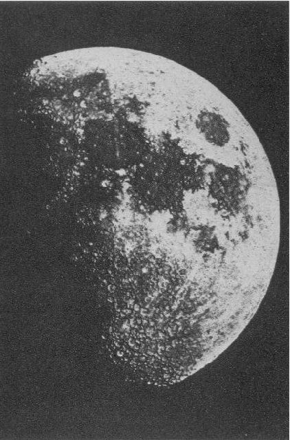 Black and white photo of the right side of the moon with black and white spots on its surface